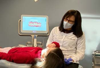 Dr. West treating a patient - West Orthodontics
